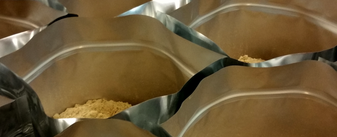About half of the Peanut Butter packages we mixed last night, waiting to be sealed. I decided it looked kinda cool so I took a picture.